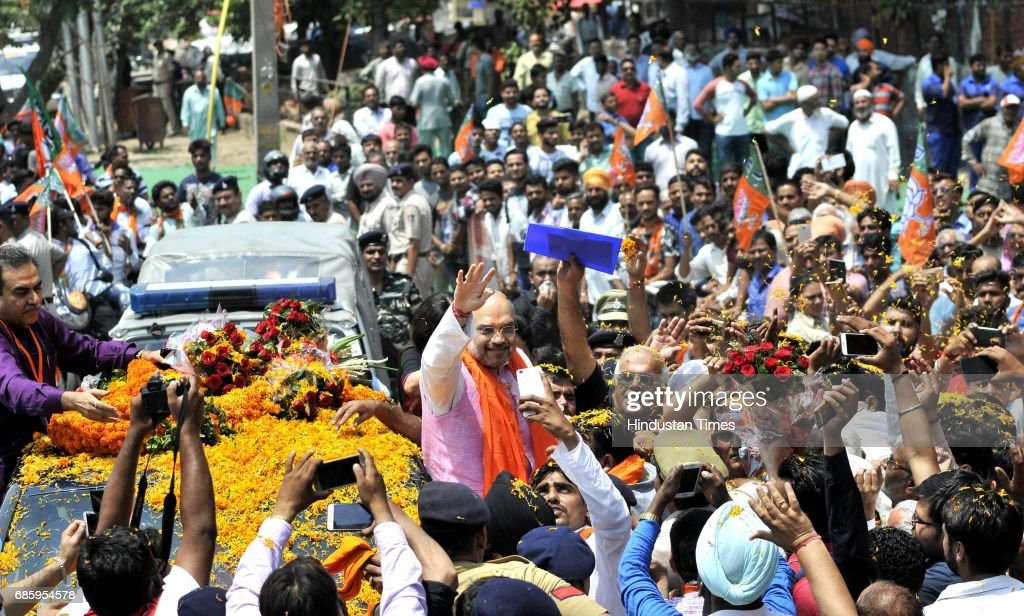 National President Amit Shah welcomed by the local leaders and supporters during the road show and inauguration of the newlyrenovated hitech BJP...