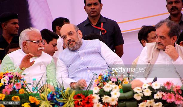 National President Amit Shah with Haryana Chief Minister Manohar Lal Khattar during a Gaurav Rally on September 11 2016 in Jind India Shah accused...