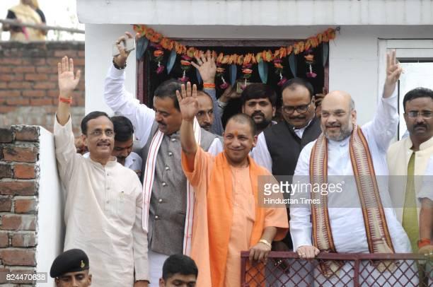 National President Amit Shah with UP CM Yogi Adityanath and Deputy CMs Keshav Prashad Maurya and Dr Dinesh Sharma at BJP worker Sonu Yadav's house at...