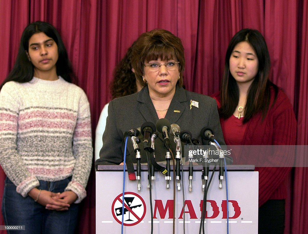 National President Elect, Wendy Hamilton, at podium, speaks with students from Montgomery Co. high schools in the background in the Rayburn building Thursday morning. The press conference was held by MADD to encourage NBC and other advertisers and media outlets, to encourage alcohol advertisers to gear their ads toward a more mature audience, not underage drinkers.