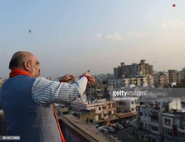 National President of the Bhartiya Janta President Amitbhai Shah flies a kite on the occasion of Uttarayan or Makarsakranti in Ahmedabad on January...