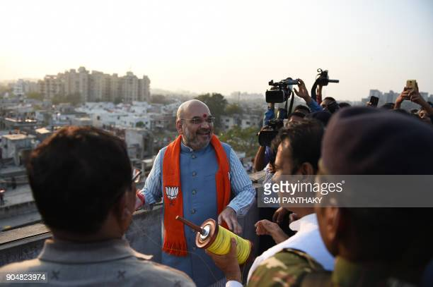 National President of the Bhartiya Janta President Amitbhai Shah looks on as he participates on the occasion of Uttarayan or Makarsakranti in...