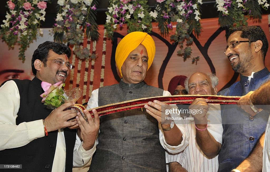 BJP National President Rajnath Singh being honored by the BJP Punjab President Kamal Sharma and Cabinet Minister Punjab Anil Joshi during the BJP State executive meeting on July 7, 2013 in Amritsar, India. BJP leaders discuss all the matters relating the preparedness for the next parliamentary polls and its ties with the alliance partner in the state Shiromani Akali Dal (Badal).