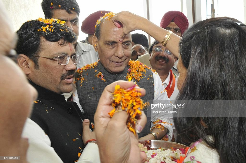 BJP National President Rajnath Singh being welcome by the female BJP workers during the BJP State executive meeting on July 7, 2013 in Amritsar, India. BJP leaders discuss all the matters relating the preparedness for the next parliamentary polls and its ties with the alliance partner in the state Shiromani Akali Dal (Badal).