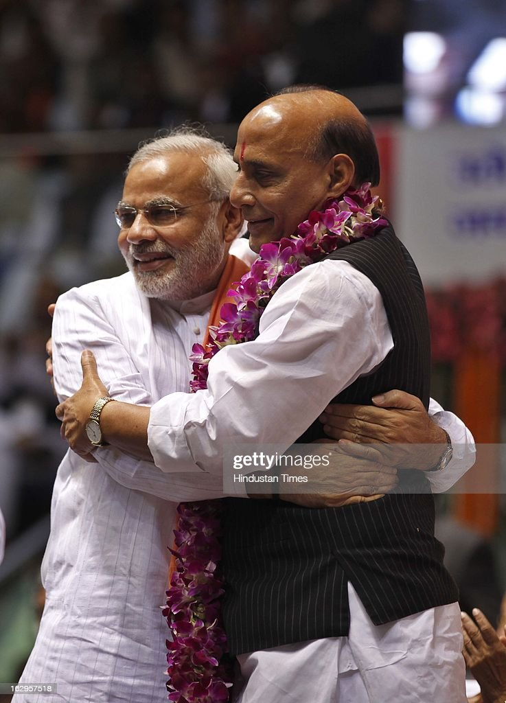 BJP National President Rajnath Singh embraces Chief Minister of Gujarat, Narendra Modi during Bharatiya Janata Party National Council meeting at Talkatora Indoor Stadium on March 2, 2013 in New Delhi, India. In his 90 minute presidential address Rajnath Singh asked the party ranks to be prepared for early Lok Sabha polls and crucial assembly elections this year, including in Karnataka, Madhya Pradesh, Chhattisgarh, Rajasthan and Delhi all very important states for BJP.