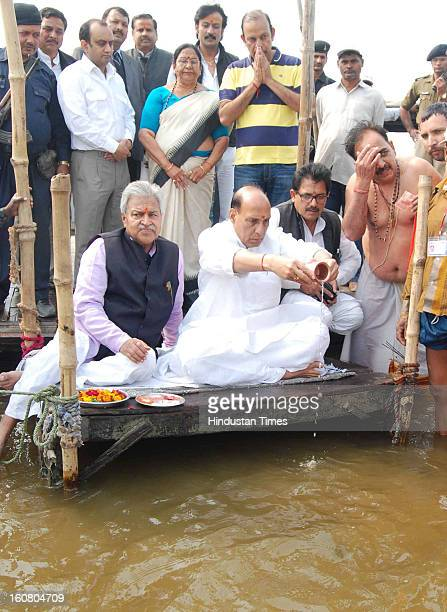 National President Rajnath Singh performing rituals after holy dip in Sangam waters in Kumbh Mela area on February 6 2013 in Allahabad India The mega...
