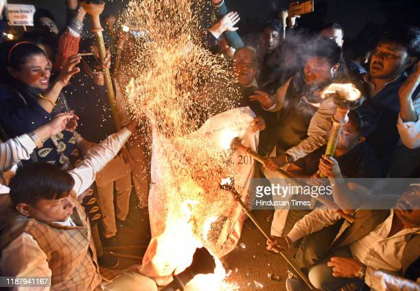 National President Srinivas B.V with party supporters during a torch procession against the Citizenship Amendment Bill at Rajpath near India Gate, on...