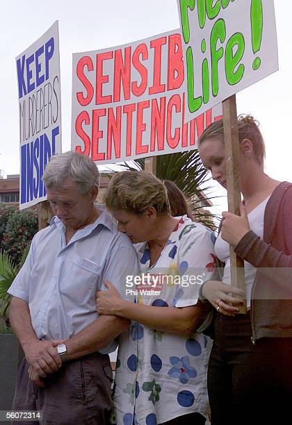 National protest organiser Garth McVicar is supported by his wife Anne and their daughter Jessica as they observe a minutes silence for Mark...