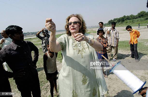 US national Rarlen Myra popularly known as Agra Chachi who has been visiting the Taj Mahal for the last 15 years flies a kite during a competition at...