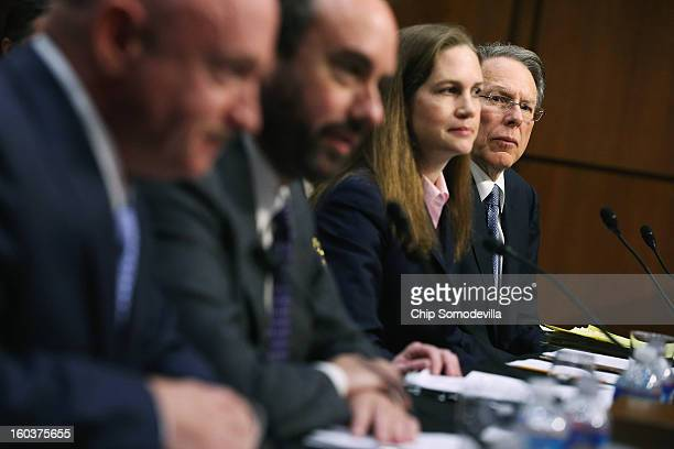 National Rifle Association Executive Vice President and Chief Executive Officer Wayne LaPierre listens to testimony from fellow witnesses retired...