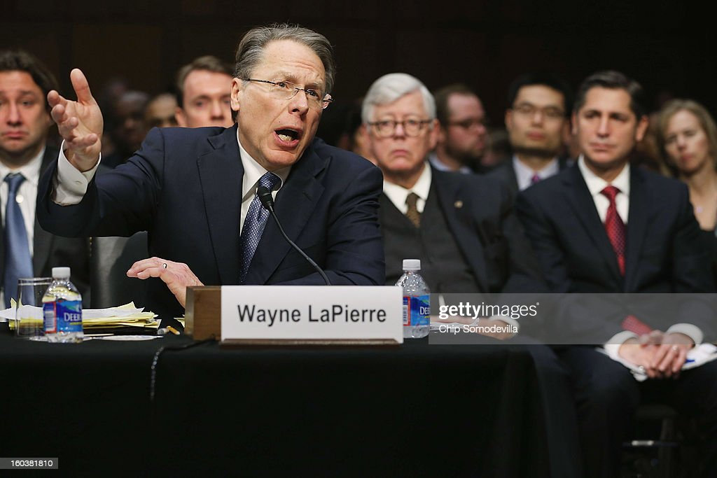 National Rifle Association Executive Vice President and Chief Executive Officer Wayne LaPierre (C) testifies before the Senate Judiciary Committee during hearing about gun control as NRA President David Keene and Brady Campaign Dan Gross (2nd R) listen on Capitol Hill January 30, 2013 in Washington, DC. Shooting victim and former U.S. Rep. Gabby Giffords (D-AZ) delivered an opening statment to the committee, which met for the first time since the mass shooting at a Sandy Hook Elementary School in Newtown, Connecticut.