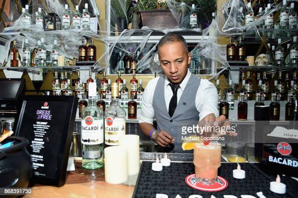 National Rum Ambassador Juan Coronado crafts a cocktail during BACARDI presents Dress To Be Free with performances by Cardi B and Les Twins at House...