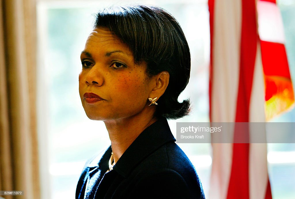 National Security Adviser Condoleezza Rice listens as President Bush meets with Colombian President Alvaro Uribe in the Oval Office of the White House.