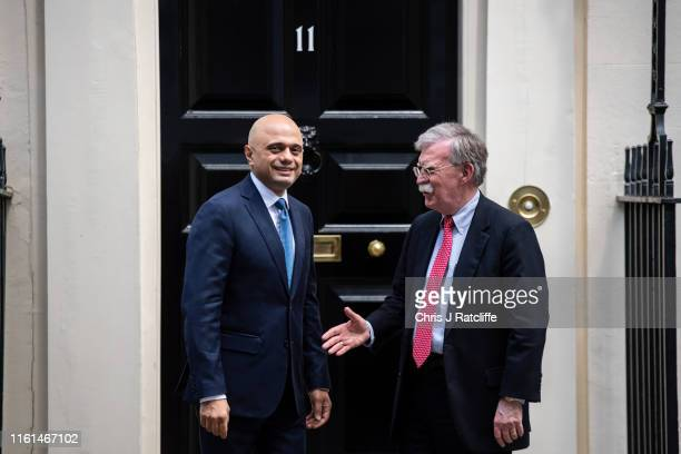 National Security Adviser John Bolton greets the Chancellor of the United Kingdom Sajid Javid at 11 Downing Street on August 13 2019 in London England