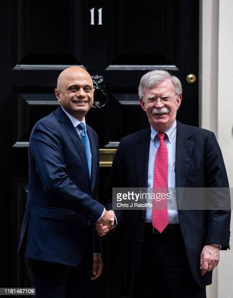 National Security Adviser, John Bolton is greeted by the Chancellor of the United Kingdom, Sajid Javid, at 11 Downing Street on August 13, 2019 in...