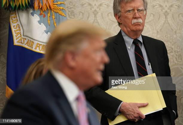 National Security Adviser John Bolton listens to US President Donald Trump speak during a meeting with Egyptian President AbdelFattah elSisi in the...
