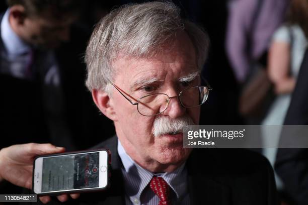 National Security Adviser John Bolton speaks to the media before the arrival of President Donald Trump during a rally at Florida International...