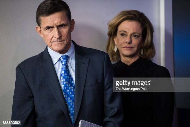 National Security Adviser Michael Flynn and KT McFarland deputy national security adviser listen as White House press secretary Sean Spicer speaks in...