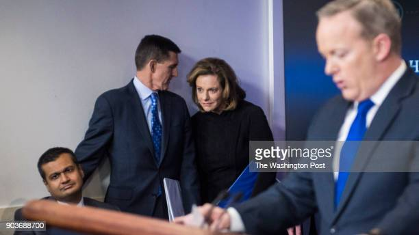 National Security Adviser Michael Flynn center left and KT McFarland deputy national security adviser center listen as White House press secretary...