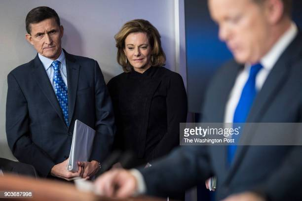 National Security Adviser Michael Flynn left and KT McFarland deputy national security adviser center listen as White House press secretary Sean...