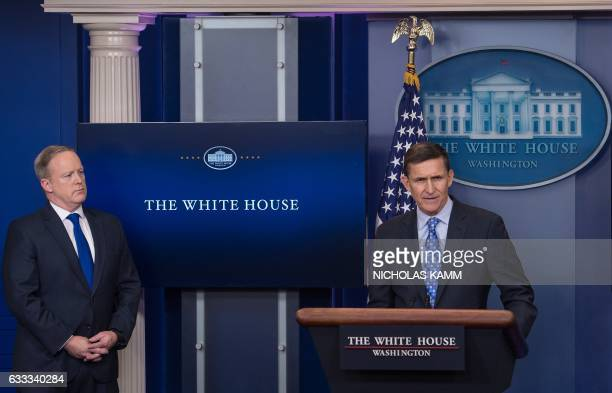 US National Security Adviser Mike Flynn speaks during the daily press briefing as Press Secretary Sean Spicer looks on at the White House in...