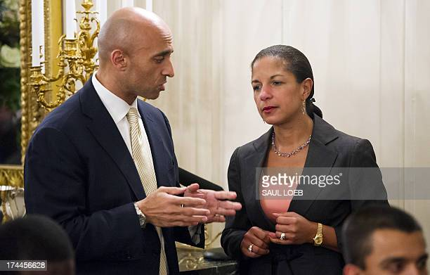 National Security Adviser Susan Rice listens to Yousef Al Otaiba Ambassador of the United Arab Emirates to the US during an Iftar dinner celebrating...