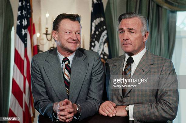 National Security Adviser Zbigniew Brzezinski and Central Intelligence Agency Director Stansfield Turner await the start of a meeting in the Cabinet...