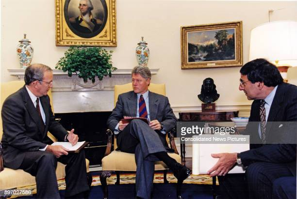US National Security Advisor Anthony Lake briefs US President Bill Clinton and White House Chief of Staff Leon Panetta in the Oval Office Washington...