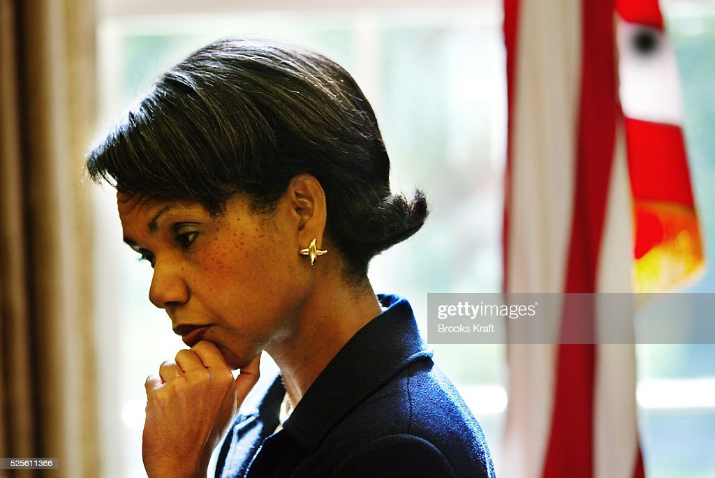 National Security Advisor Condoleezza Rice looks thoughtful after a meeting in the Oval Office of the White House. She has been talking with Secretary of State Colin Powell after the meeting between President George W. Bush and Colombian President Alvaro Uribe on Wednesday, September 25, 2002.