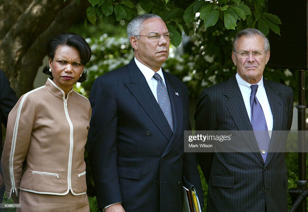 National Security Advisor Condoleezza Rice, Secretary of State Colin Powell and Secretary of Defense Donald Rumsfeld attend a news conference with U.S. President George W. Bush and Afghan President Hamid Karzai in the Rose Garden at the White House June 15, 2004 in Washington DC. The two leaders met to discuss the war on terrorism.