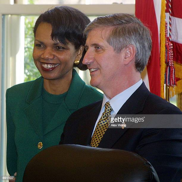 National Security Advisor Condoleezza Rice speaks with White House Chief of Staff Andrew Card during a meeting between U S President George W Bush...