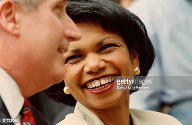 US National Security Advisor Condoleezza Rice talks to White House Chief of Staff Andy Card during a joint press conference with President George W...