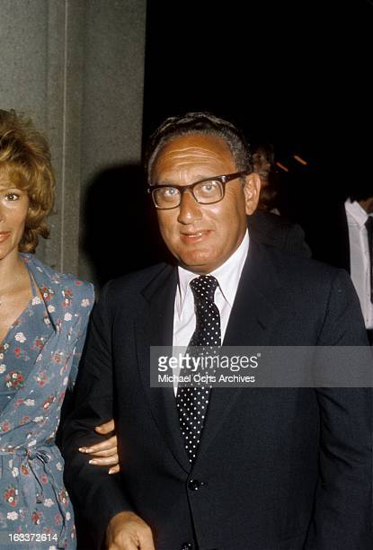 National Security Advisor Henry Kissinger escorts actress Jill St John to an event circa 1970 in Los Angeles California