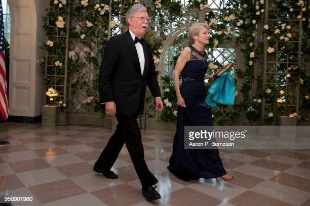 National Security Advisor John Bolton and his wife Gretchen arrive at the White House for a state dinner April 24 2018 in Washington DC President...