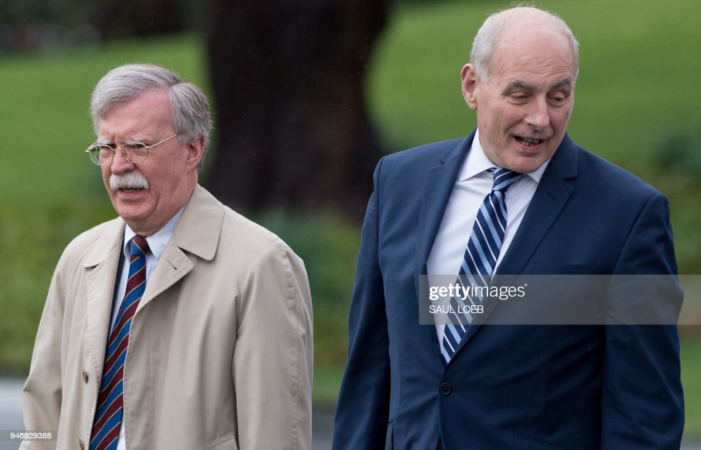 National Security Advisor John Bolton (L) and White House Chief of Staff John Kelly walk to board Marine One prior to departure with US President Donald Trump from the South Lawn of the White House in Washington, DC, April 16, 2018, as Trump travels to Florida. /
