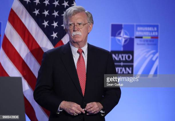 S National Security Advisor John Bolton listens as US President Donald Trump speaks to the media at a press conference on the second day of the 2018...