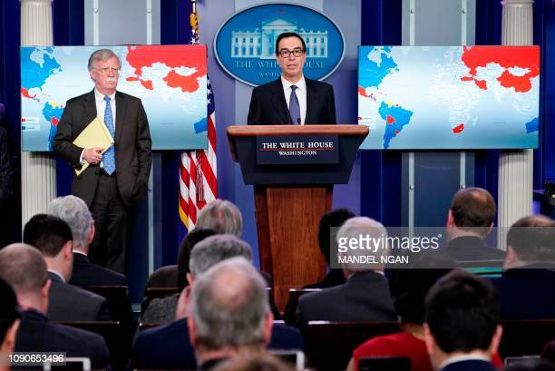 National Security Advisor John Bolton looks on as US Secretary of the Treasury Steven Mnuchin speaks during a briefing in the Brady Briefing Room of...
