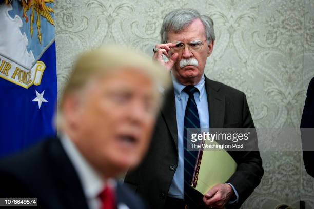 National security advisor, John Bolton, right, attends a meeting with President Donald Trump and President of Chile, Sebastian Piñera in the Oval...