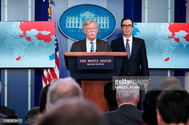 National Security Advisor John Bolton speaks as US Secretary of the Treasury Steven Mnuchin looks on during a briefing in the Brady Briefing Room of...