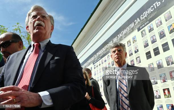 National Security Advisor of the United States John Bolton speaks to the press as former US ambassador to the Ukraine and current Chargé dAffaires ai...