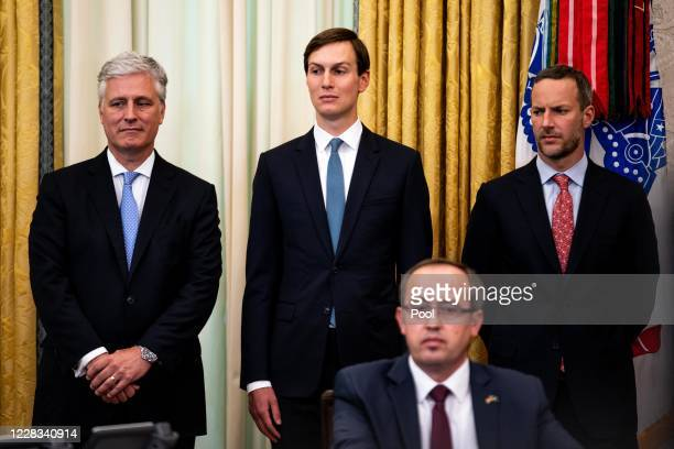 National Security Advisor Robert O'Brien and advisor Jared Kushner attend a signing ceremony and meeting with US President Donald Trump and the...