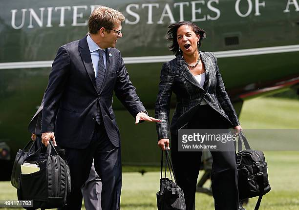 National Security Advisor Susan Rice and Press Secretary Jay Carney return to the west wing of the White House after traveling with U.S. President...