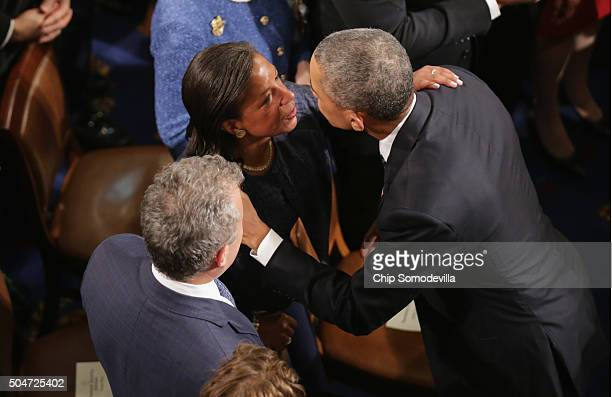 National Security Advisor Susan Rice and US President Barack Obama embrace after delivering the State of the Union speech before members of Congress...