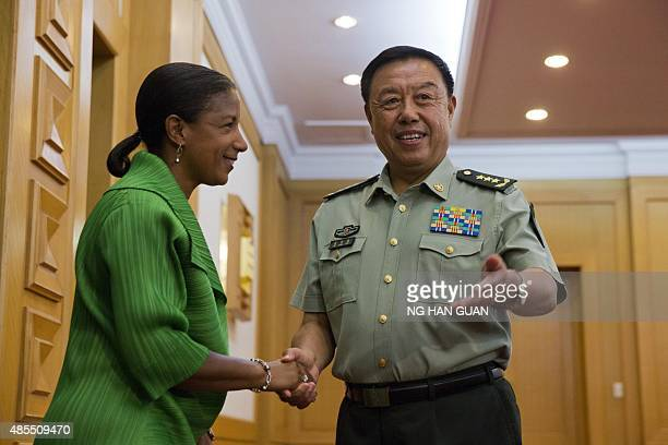 US National Security Advisor Susan Rice shakes hands with Central Military Commission Vice Chairman Fan Changlong at the Chinese Ministry of National...
