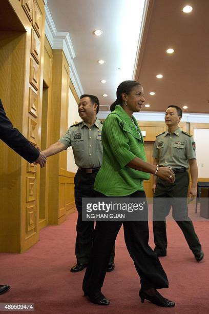 US National Security Advisor Susan Rice walks past Chinese Central Military Commission Vice Chairman Fan Changlong as he greets US Ambassador to...
