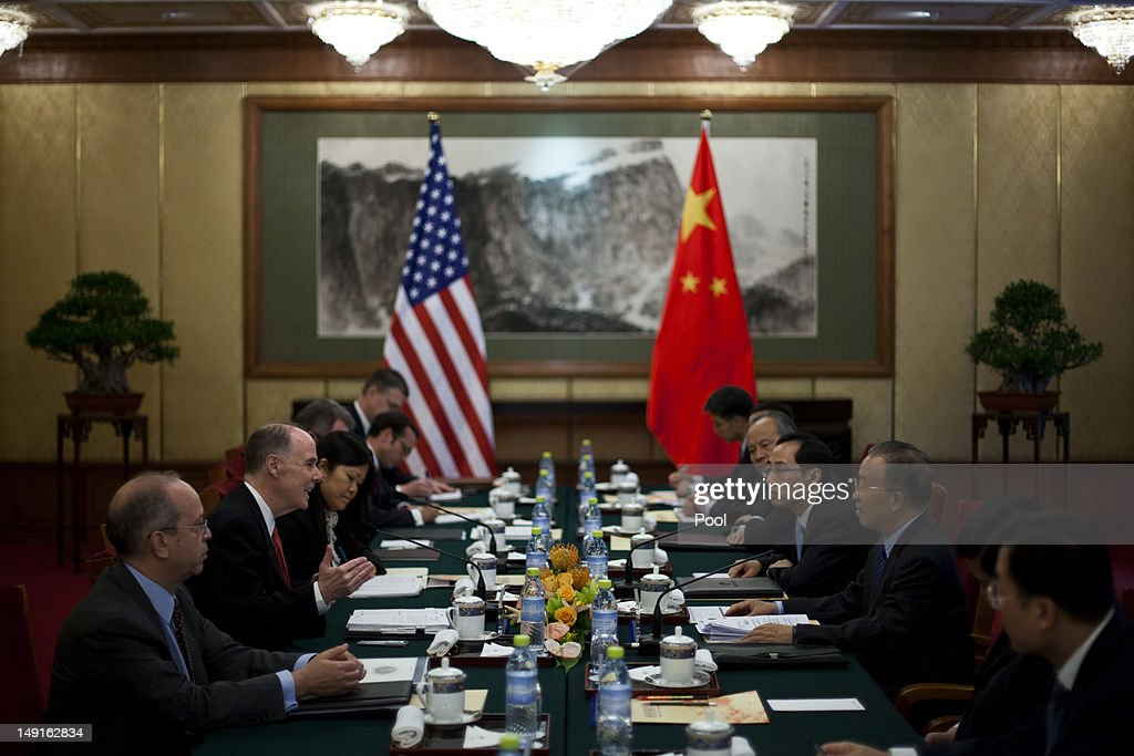 U.S. National Security Advisor Tom Donilon (2nd-L), talks to Chinese State Councilor Dai Bingguo (2nd-R), during their meeting at the Diaoyutai State Guesthouse on July 24, 2012 in Beijing, China. The two are expected to discuss a range of international issues, including Syria, Iran and N. Korea.