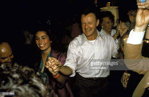 "National security advisor Zbigniew Brzezenski disco dancing with Dolly Fox after going to the premier of the movie ""Hair""."