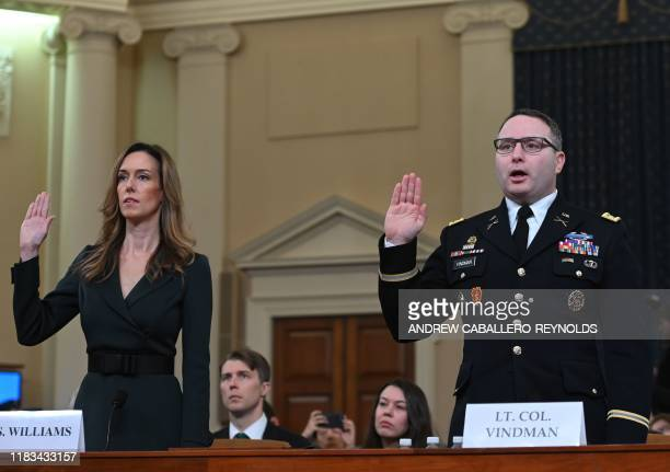National Security Council Ukraine expert Lieutenant Colonel Alexander Vindman and Jennifer Williams an aide to Vice President Mike Pence take the...