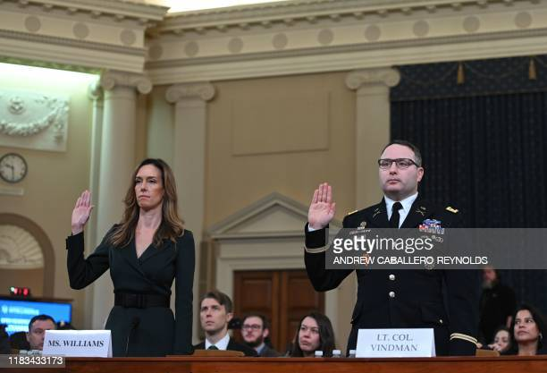 National Security Council Ukraine expert Lieutenant Colonel Alexander Vindman and Jennifer Williams an aide to Vice President Mike Pence are sworn in...