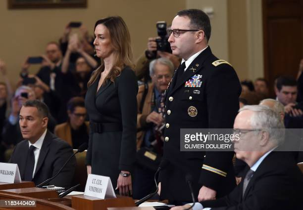 National Security Council Ukraine expert Lieutenant Colonel Alexander Vindman and Jennifer Williams an aide to Vice President Mike Pence arrive to...